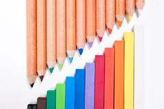 View of different color pencils and chalk pastels isolated on the white backg Stock Photos