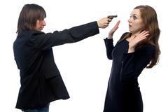 Man threatening woman - stock photo