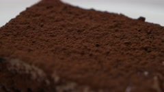Cocoa powder on the chocolate cake closeup Stock Footage