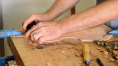 Luthier working in a violin Stock Footage