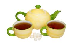 Tea service isolated on white. - stock photo