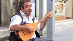 Street musician on the istiklal street in Istanbul, Turkey. Stock Footage