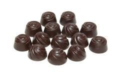 Delicious dark chocolate pralines isolated on white. - stock photo