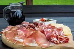 typical Italian appetizer with salami, cheese and pickles - stock photo
