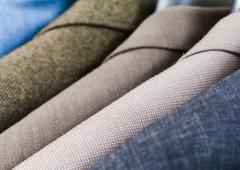 Finished male coats in tailoring atelier Stock Photos