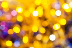 Yellow pink blurred shimmering Christmas lights Stock Photos