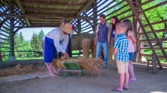 Tying bundles of straw in the traditional way Stock Footage