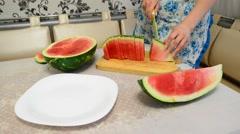 woman cuts  big ripe watermelon - stock footage