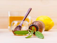 Cup of herbal tea with  fresh sage ,honey and lemon on wooden background. Stock Photos