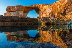 Azure Window, famous stone arch on Gozo island with reflection, Malta - stock photo