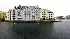 Skyline of Alesund, Norway, houses on the water, boats, yachts Stock Footage