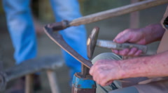 Man repairing piece with hammer Stock Footage