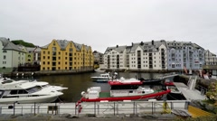 Stock Video Footage of Skyline of Alesund, Norway, houses on the water, boats, yachts