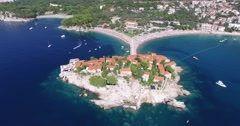 Aerial view of the Sveti Stefan, small islet and resort in Montenegro Stock Footage