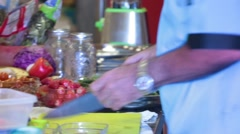 Slicing Strawberries for Fresh Fruit Salad Stock Footage