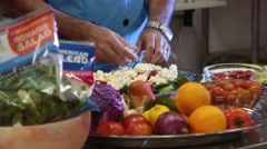 Breaking Up Feta Cheese and Placing on Salad Stock Footage