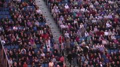 People at tribune stadium Stock Footage