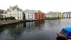 Stock Video Footage of Pan Skyline of Alesund, Norway, houses on the water, boats, yachts