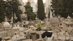 Tilt Down Shot of Ornate Gravestones in Old Cemetery Stock Footage