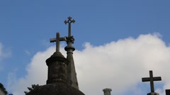 Pan Shot of Silhouetted Crosses on top of Gravestones in Cemetery Stock Footage