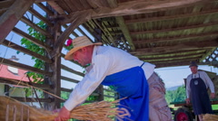 Men working with straw on countryside Stock Footage