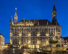 The historic town hall of Aachen, Germany with night blue sky and the Karlsbr - stock photo