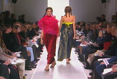 Fashion models walking on runway for Han Feng Collection - stock footage