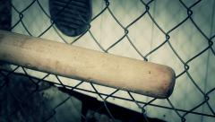 Baseball bat with focus on wire fence Stock Footage