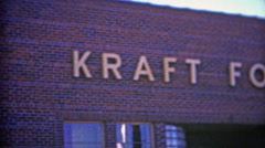 1953: Kraft foods company enterance where two workers emerge. Stock Footage