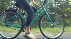 A woman biking in a forest on bike trail Stock Footage