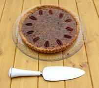 Pie server with pecan pie - stock photo