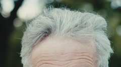 Seniors portrait of contemplative old caucasian man. Close up Stock Footage