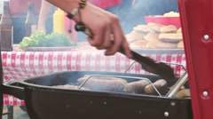 Tailgate: Close Up Of Man Cooking Sausage And Bugers Stock Footage