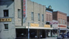 1953: Main street USA Safeway grocery store and downtown. Stock Footage