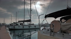 Modern sailing yachts moored in marina, 4k Stock Footage