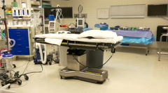 4K slow tracking shot of empty operating table Stock Footage