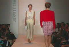 Fashion models walking on runway for Jeffrey Chow Collection Stock Footage