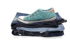 Jeans and green sneakers - stock photo
