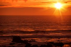 Scenic Pacific Ocean Sunset in California, United States. - stock photo