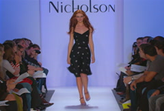 Fashion models walking on runway for Jennifer Nicholson Collection Stock Footage