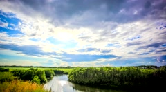 Timelapse of sunset reflected on River in Siberia during rain at forest Stock Footage