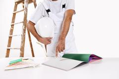 Painter man choose color from samples Stock Photos