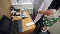 Female doctor in lab coat clean cap for electroencephalography Stock Footage
