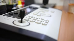 Close-up remote control panel with joystick and ring at desk. Stock Footage