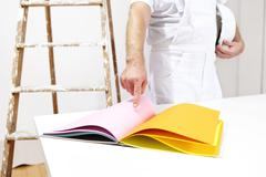 painter man choose color from samples - stock photo
