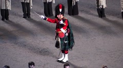 Scotland. Bagpipes military parade. orchestra director.audio - stock footage