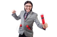 Stock Photo of Young businessman holding dynamite isolated on white
