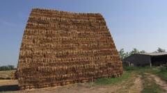 Stacked bales of hay, rural scene Stock Footage