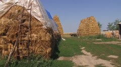 Rural household, hay bales and barn Stock Footage