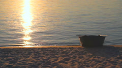 Stock Video Footage of boat on a riverbank at sunset